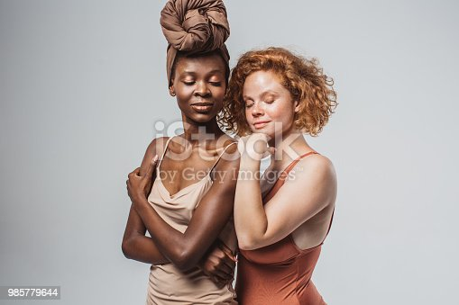 Two young women with different body type in underwear. Studio shot