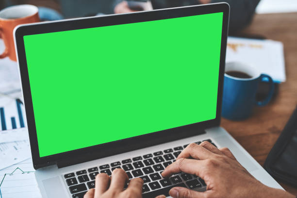 Stay online, stay informed Cropped shot of a businessman using a laptop with a green screen at work zoom effect stock pictures, royalty-free photos & images