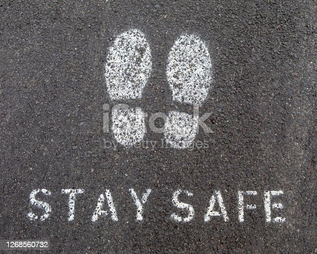 A painted symbol or message on the ground reminding people to Stay Safe - during the Coronavirus pandemic in the UK.