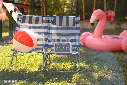 Two lounge chairs and sign staycation