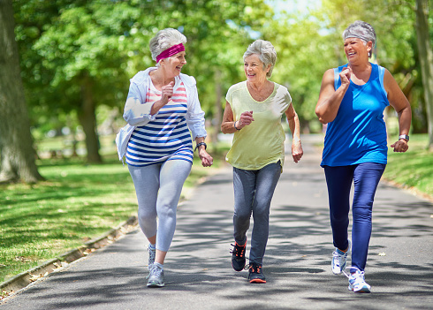 Shot of a group of elderly friends enjoying a run together outdoors