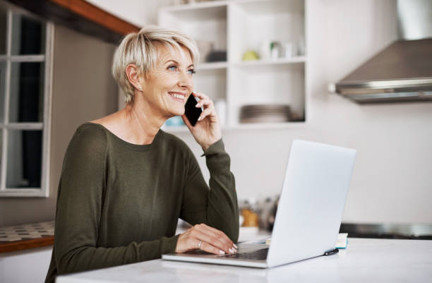 staying close and connected - older woman phone stock photos and pictures