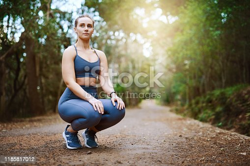 Shot of a sporty young woman exercising outdoors