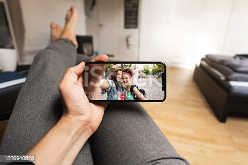 istock Staying connected with friends on video call from home 1226940828