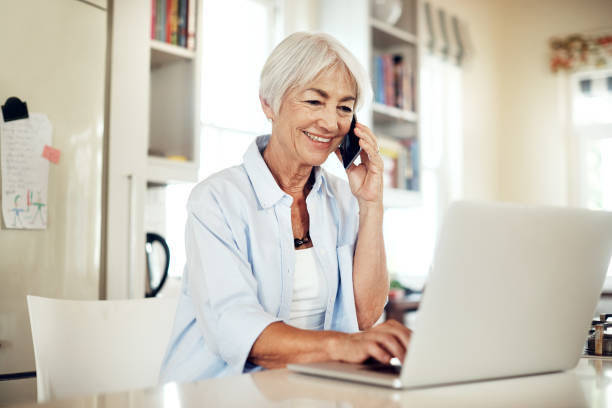 staying engaged and social - older woman phone stock photos and pictures