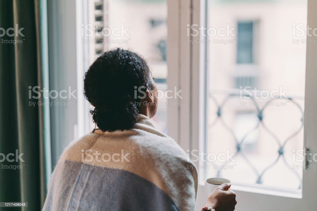 Staying home during COVID-19 pandemic Woman in quarantine staying home, drinking coffee feeling depressed Accidents and Disasters Stock Photo