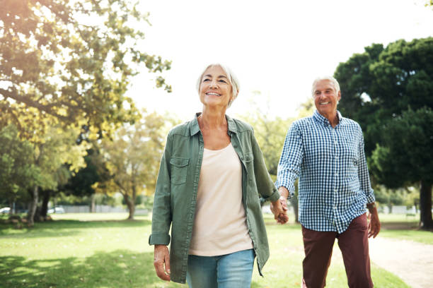 Staying in love is something very special Shot of a happy senior couple going for a walk in the park husband stock pictures, royalty-free photos & images