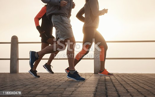 Shot of a small group of three people out for a run together on the promenade
