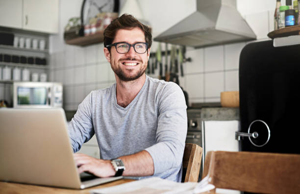 Staying in the know from the comfort of home stock photo