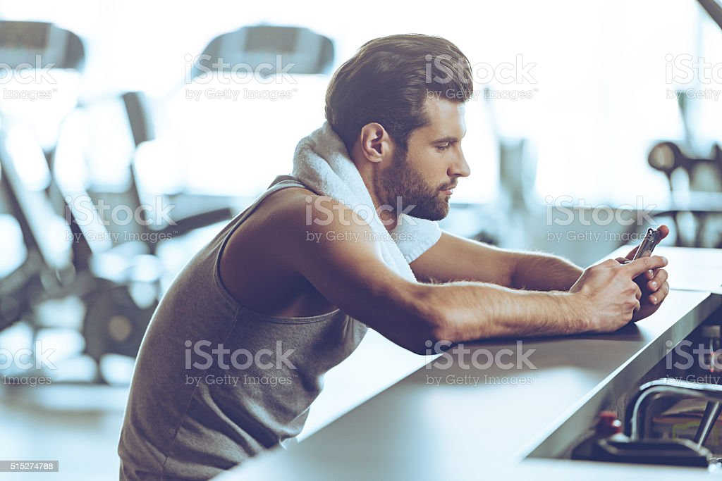 Staying in touch at gym. stock photo