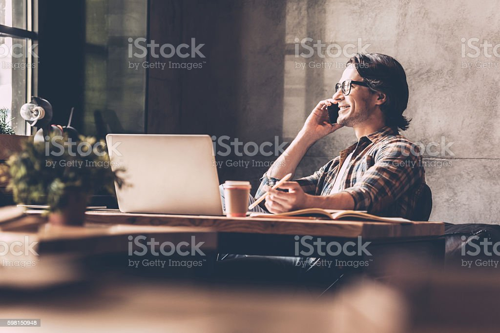 Staying in touch with his colleagues. stock photo