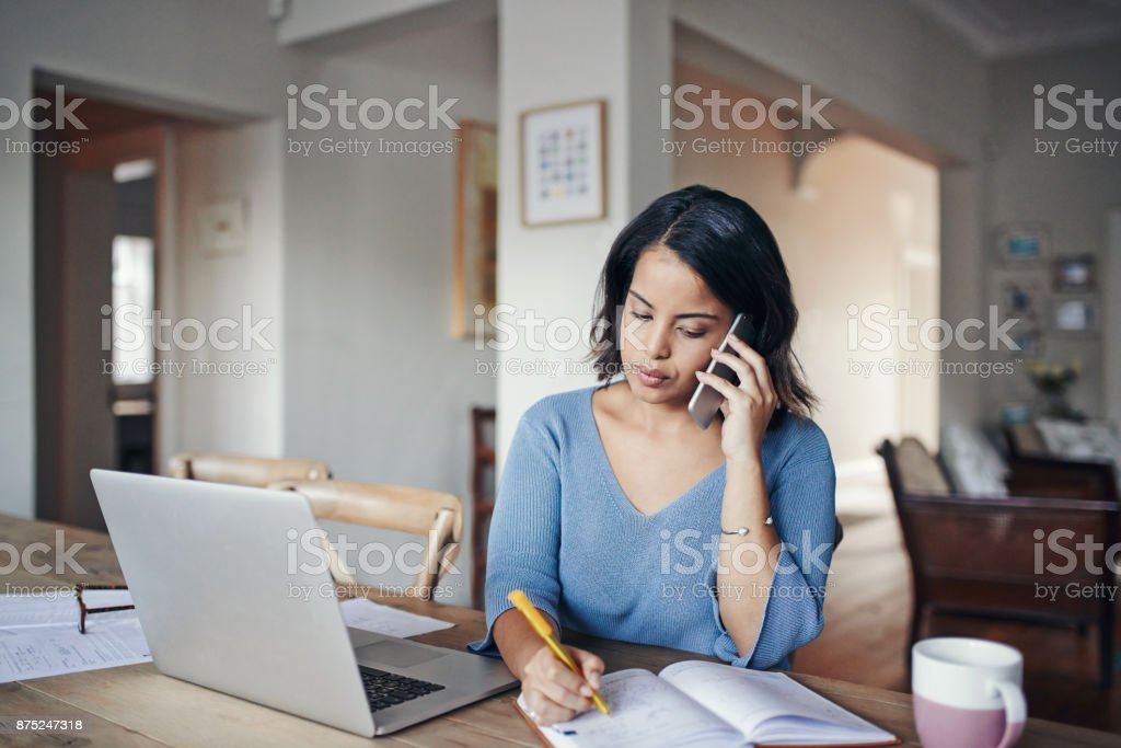 Staying in touch with the office from home stock photo