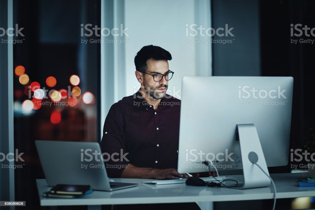 Staying late to get it done stock photo