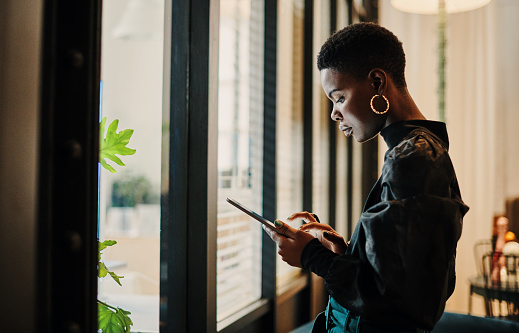 Shot of a young businesswoman using a digital tablet in an office
