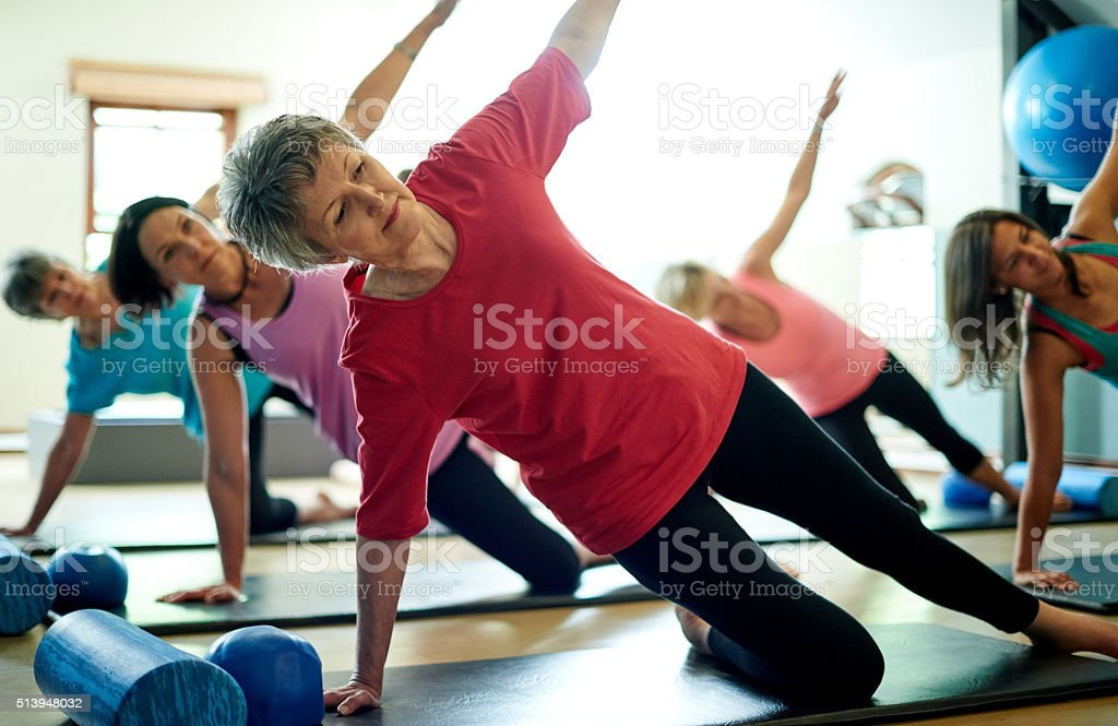 Staying supple in her senior years with pilates royalty-free stock photo