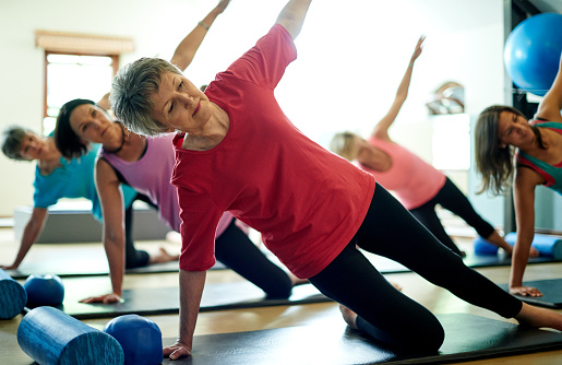 istock Staying supple in her senior years with pilates 513948032