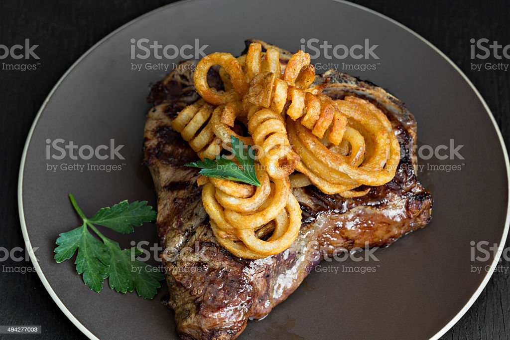 Steak And Curly Fries royalty-free stock photo