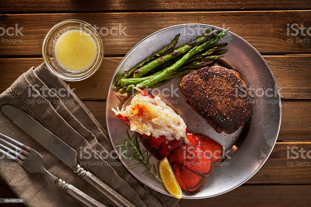 steak and lobster dinner flat lay composition top down overhead view of steak and lobster dinner Asparagus Stock Photo