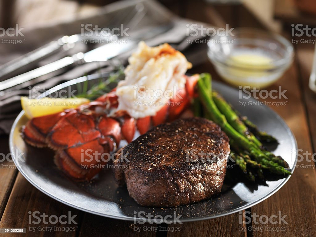 steak and lobster surf & turf gourmet dinner with asparagus stock photo