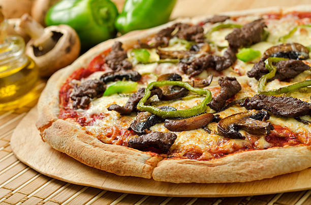 Steak and Mushroom Pizza stock photo