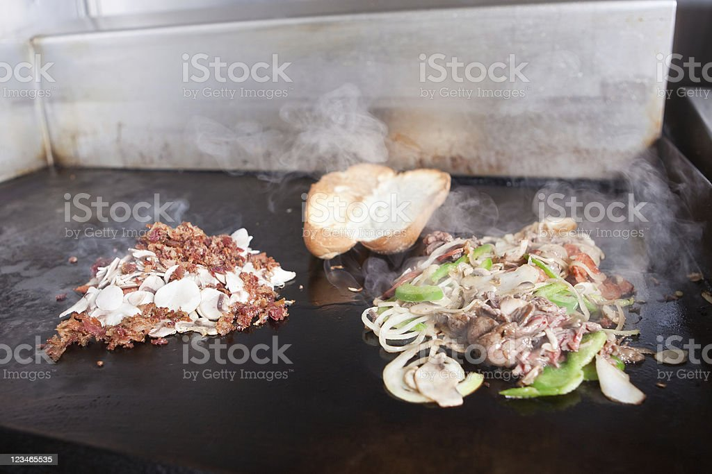 Steak and Peperoni Submarine Sandwich (right) Bacon Mushrooms (left) royalty-free stock photo