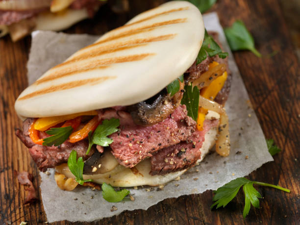 Steak and Peppers on Grilled Bao Buns stock photo