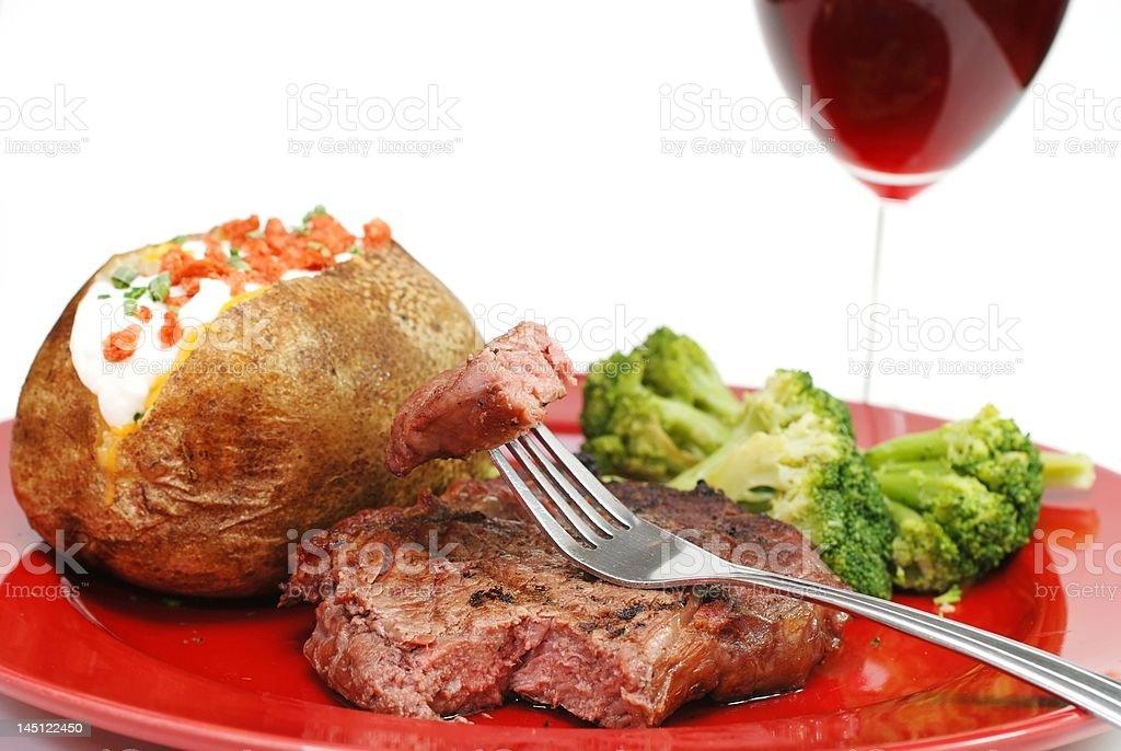 Steak and Potato Isolated royalty-free stock photo