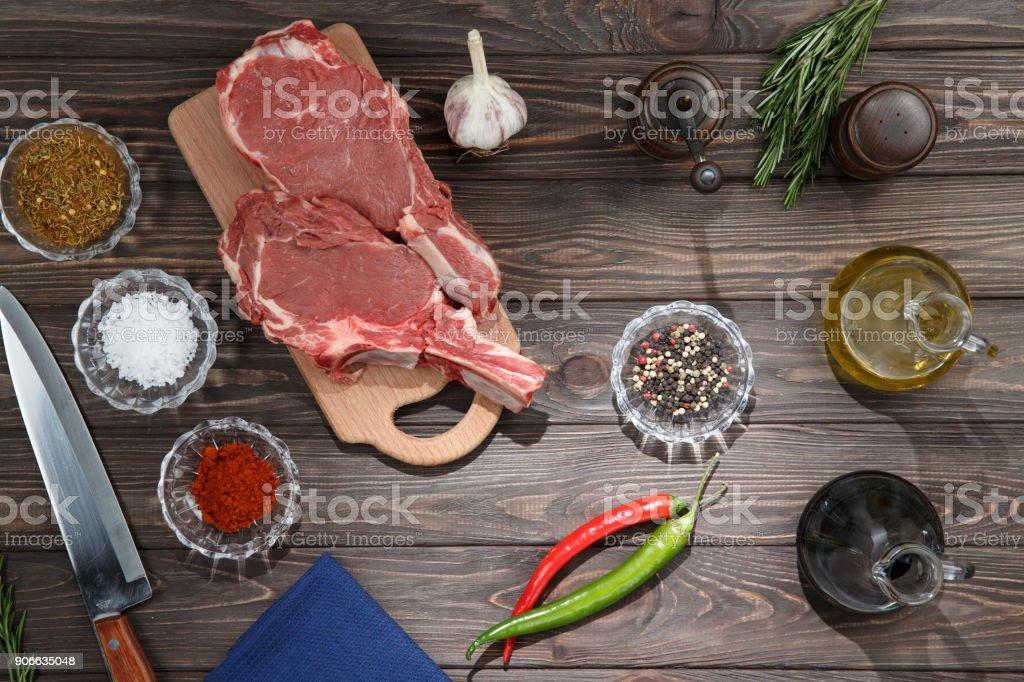 Steak and spices on wooden table. Top view. stock photo
