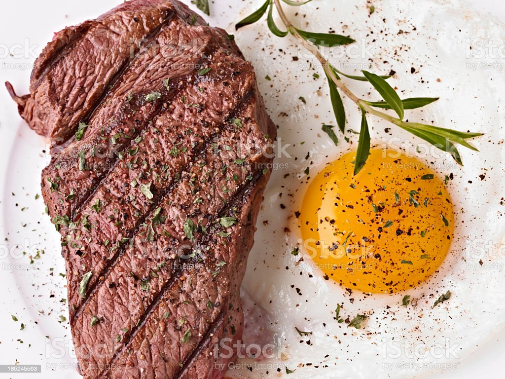 Steak and sunny side up egg with seasoning stock photo