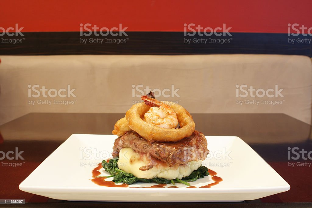 Steak and Tempura Prawns stock photo