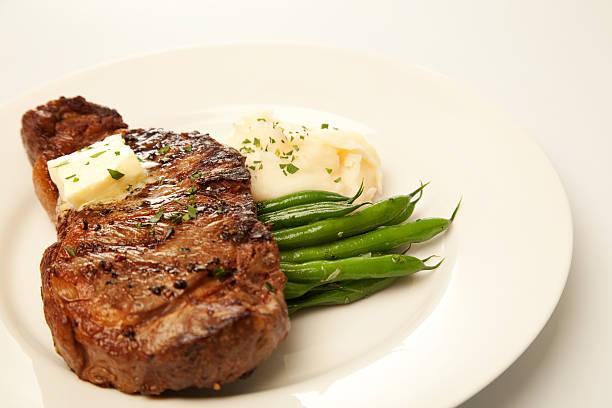 steak-abendessen - steak anbraten stock-fotos und bilder