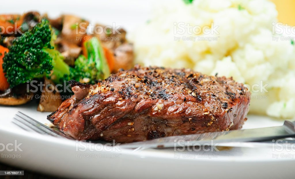 A steak dinner with mashed potatoes and vegetable medley royalty-free stock photo