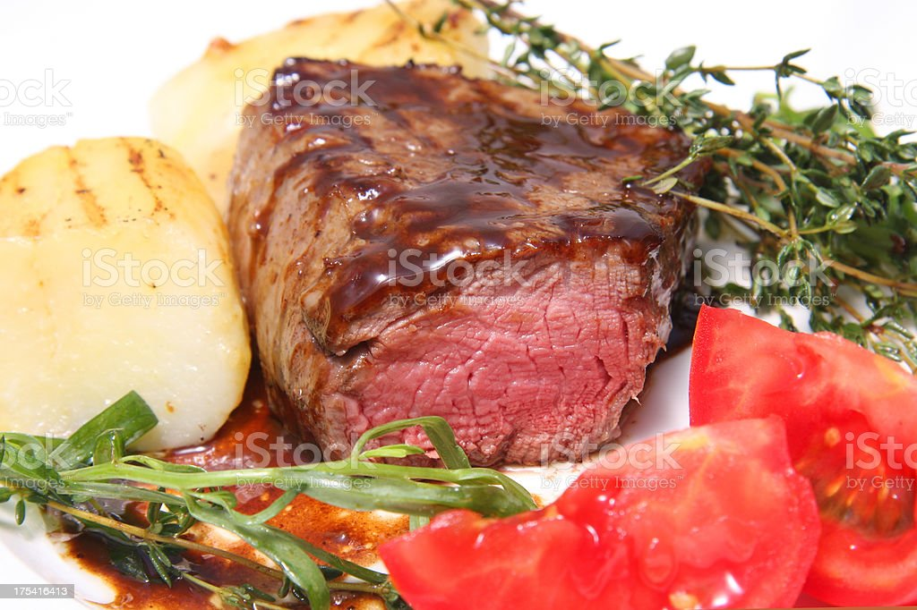 Steak Filet Mignon with herbs and vegetables royalty-free stock photo