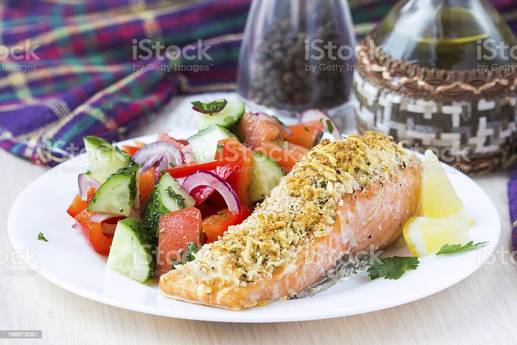 Steak fillet of red fish salmon with cheese crust breading stock photo