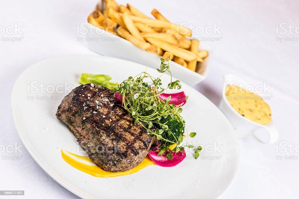 Steak fries and bearnaise sauce stock photo