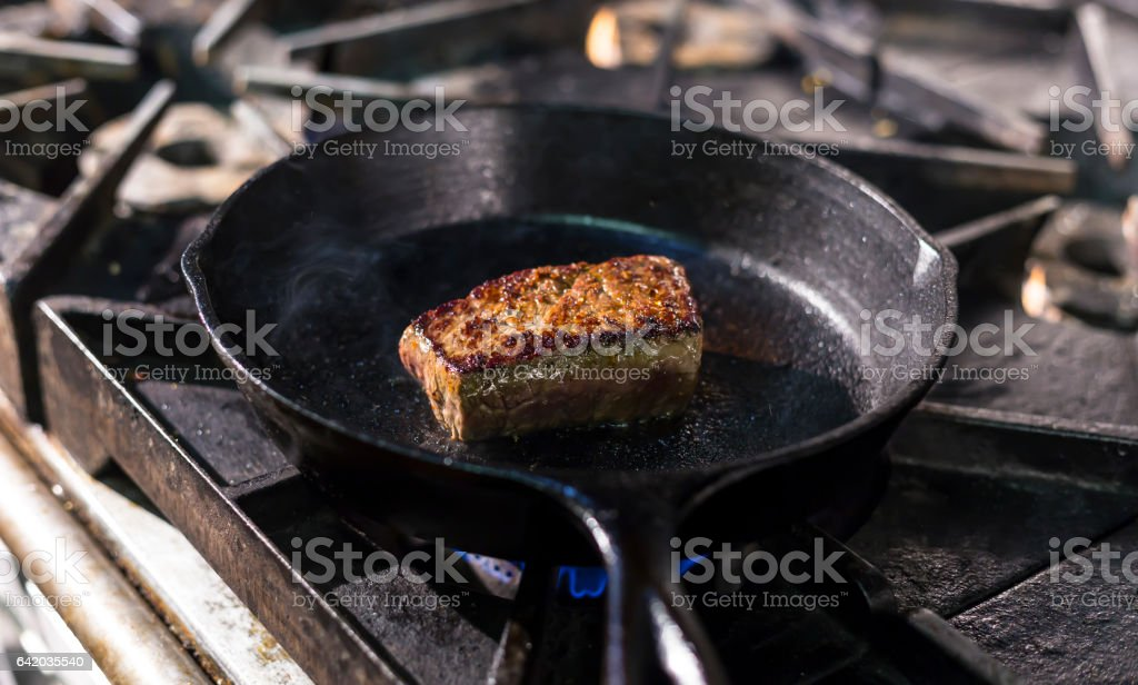 Steak in a cast iron skillet stock photo