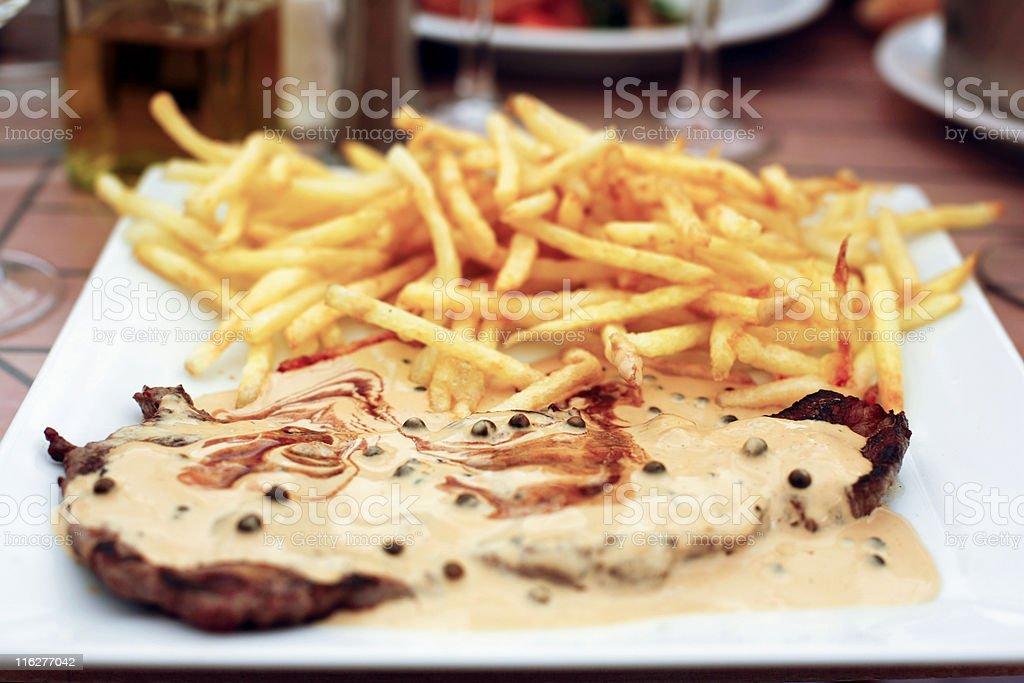 Steak in pepper sauce stock photo