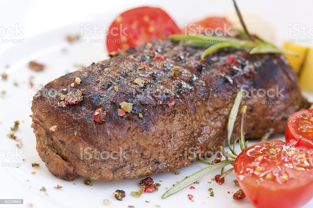 Steak meal garnished with cherry tomatoes and herbs royalty-free stock photo