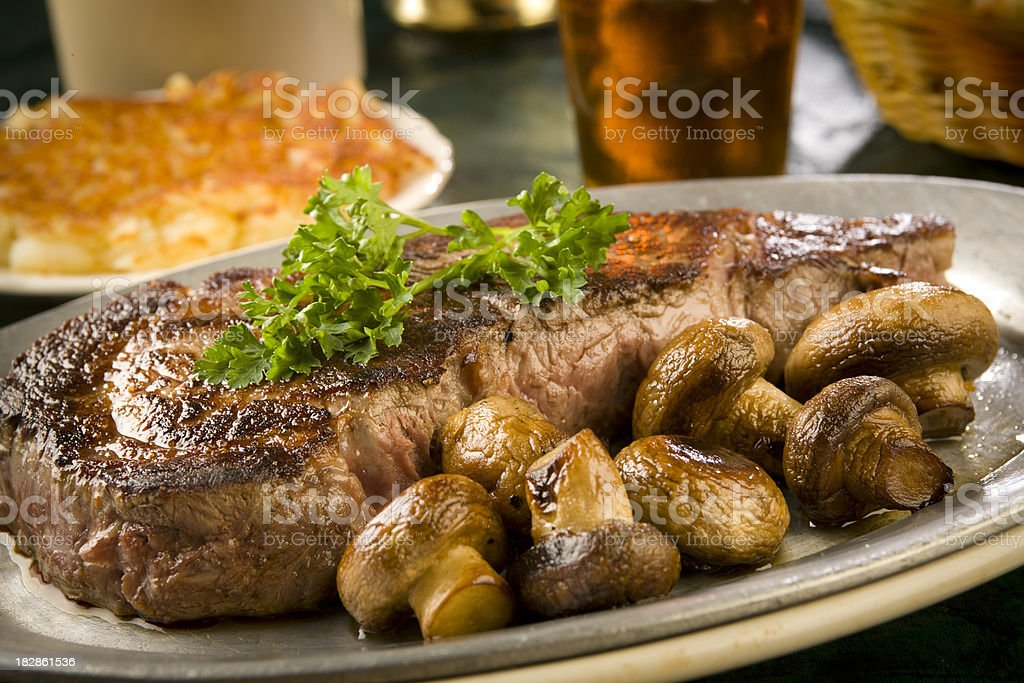 Steak, mushrooms, hash browns - adobe RGB stock photo