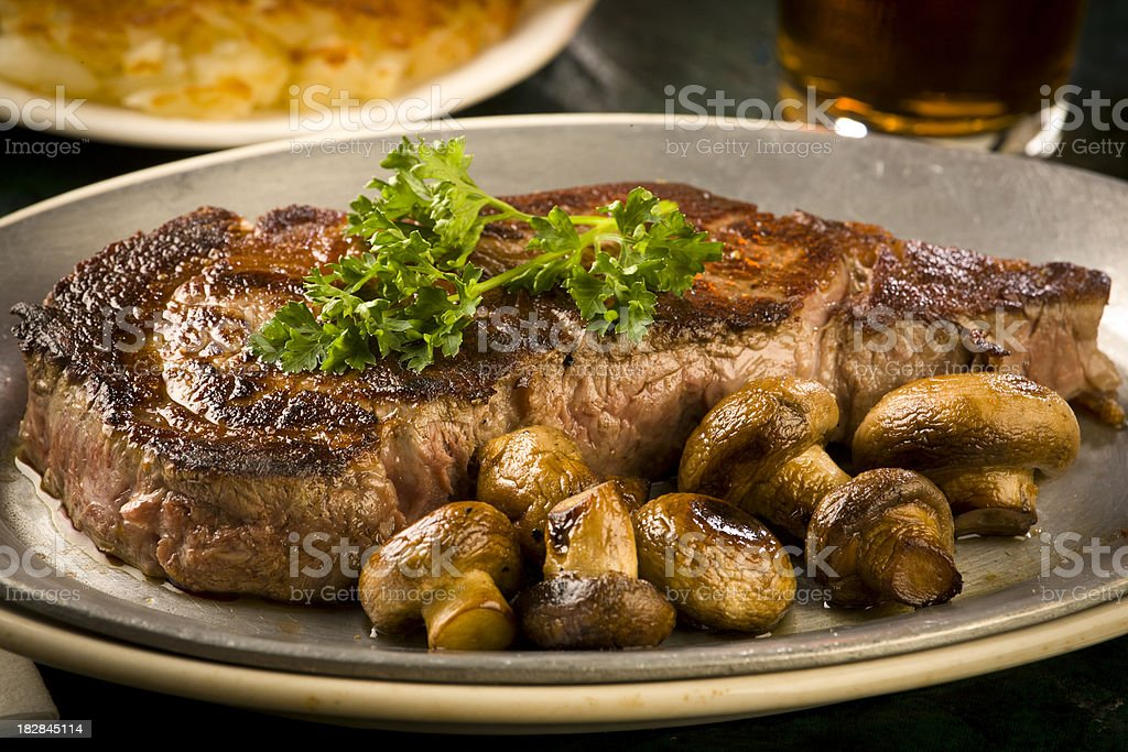 Steak, mushrooms, hash browns, cloesup, adobe RGB royalty-free stock photo