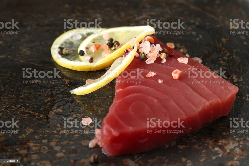 Steak of tuna for grilling. Dark background. Seafood. stock photo