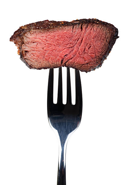 steak on a fork stock photo
