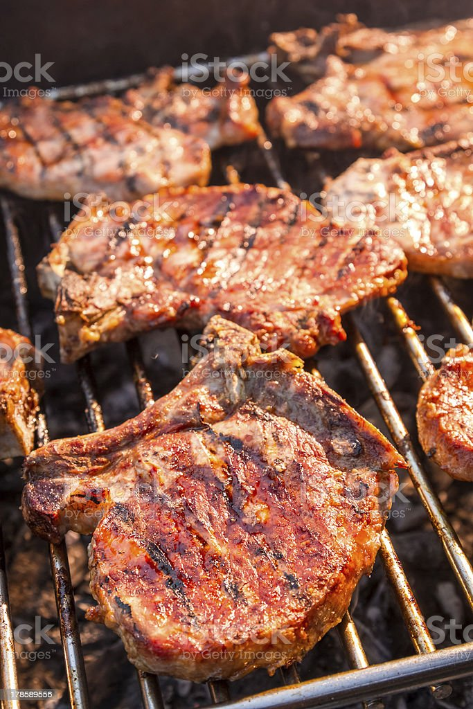 Steak on grill fire-toasted royalty-free stock photo
