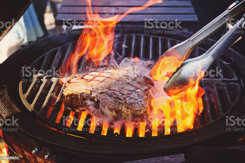 Steak on the grill with flames stock photo