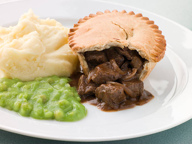Steak Pie Mash and Mushy Peas stock photo