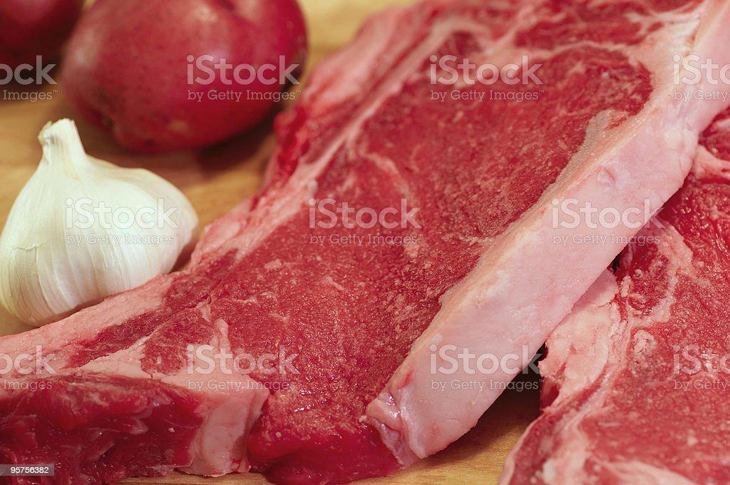 Steak, potatoes, garlic royalty-free stock photo