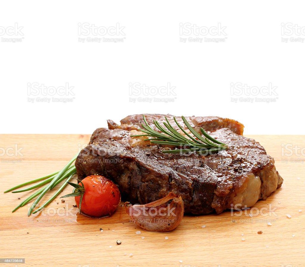 Steak rib-eye garnished with grilled stock photo