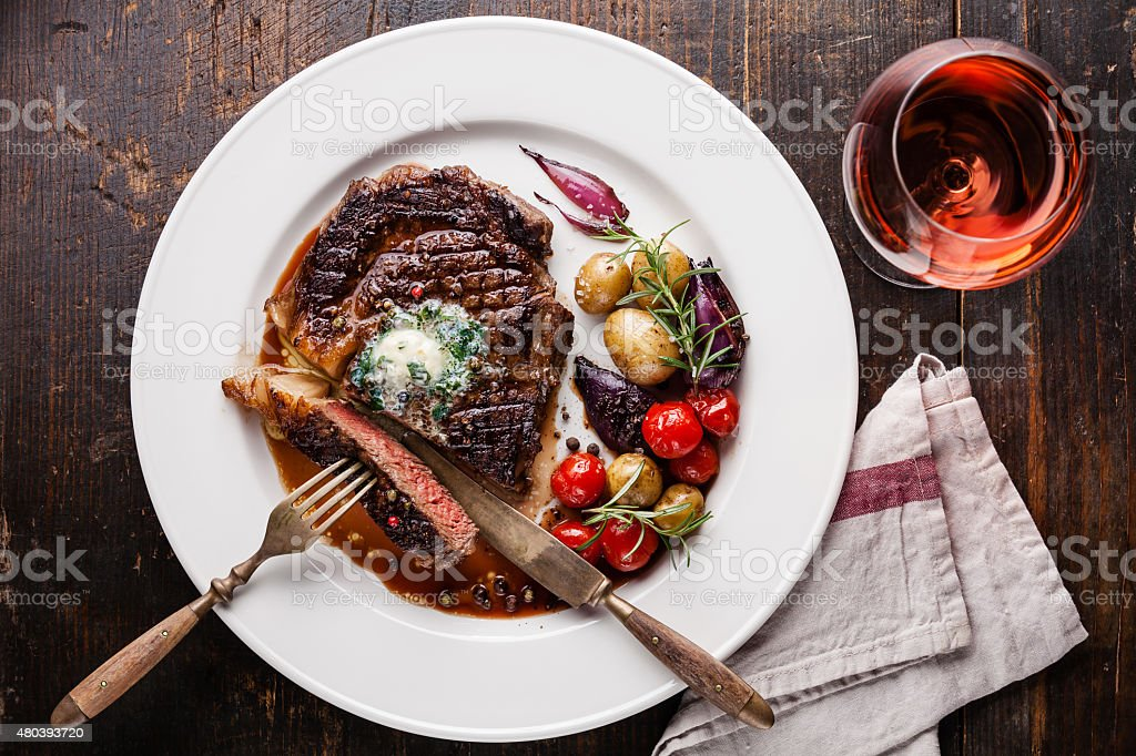 Steak Ribeye with herb butter and baby potatoes stock photo