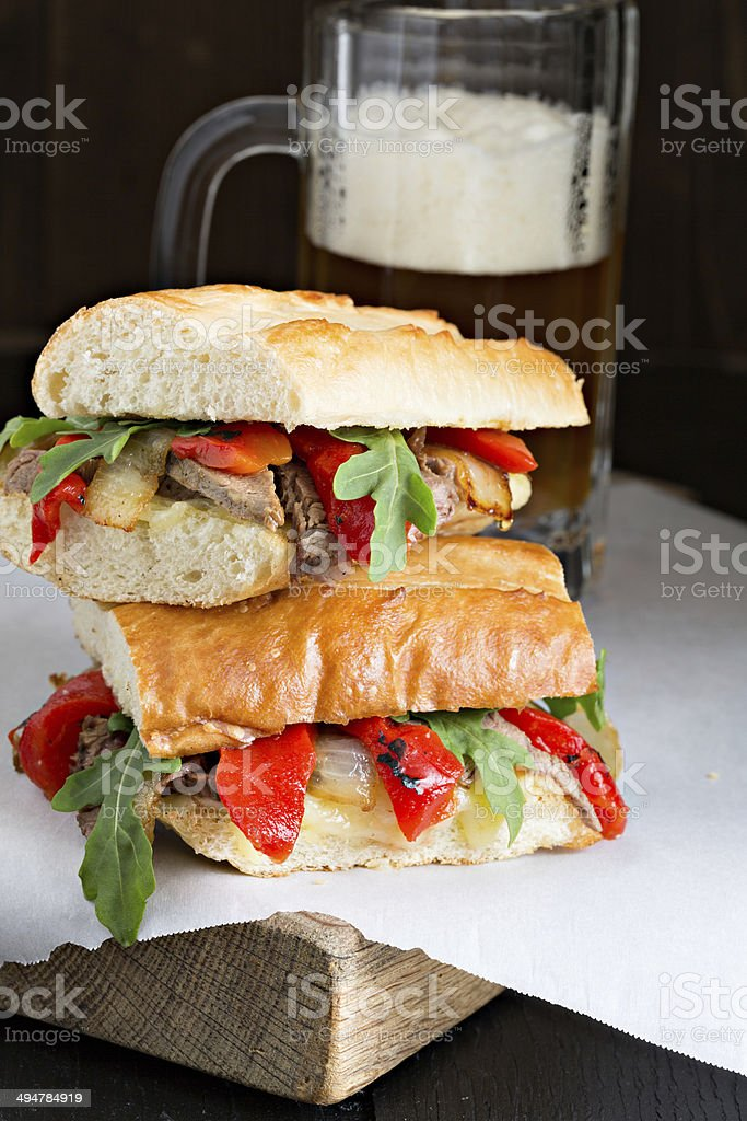Steak Sandwich And A Mug Of Beer royalty-free stock photo