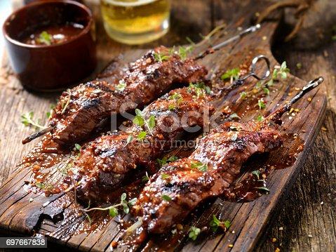 Seasoned BBQ Steak Skewers with Fresh Herbs and a couple of Beers